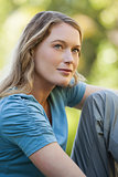 Close-up of thoughtful woman looking up in park