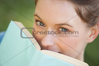 Extreme close-up portrait of beautiful woman with book