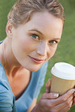 Pretty young woman holding a coffee cup