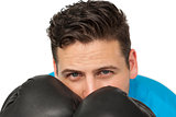 Close-up of a determined male boxer focused on training