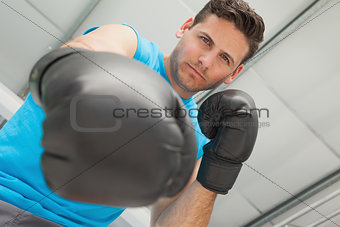 Determined male boxer focused on training