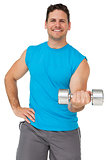 Portrait of a fit man exercising with dumbbell