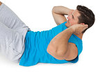 Side view of a man doing abdominal crunches