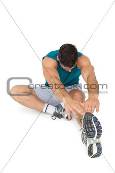 Full length of a fit young man doing stretching exercise