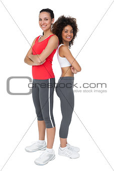 Portrait of two fit young women with arms crossed