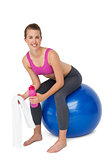Portrait of a fit woman sitting on exercise ball
