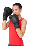 Portrait of a determined female boxer focused on her training