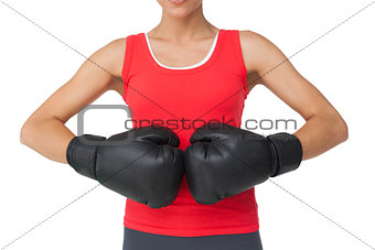 Close-up mid section of a determined female boxer
