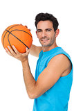 Portrait of a basketball player with ball