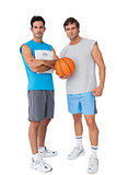 Two fit young men with scales and basketball