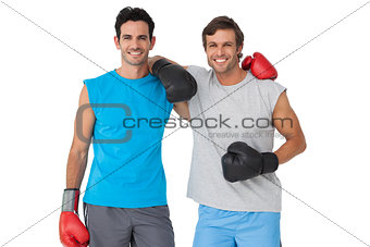 Portrait of two smiling male boxers
