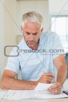 Focused man working out his finances