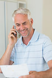 Smiling man on a phone call