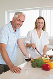 Cheerful couple making dinner together