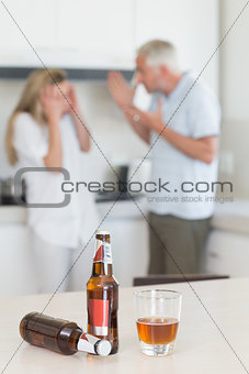 Angry couple arguing after drinking alcohol