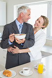 Smiling couple having breakfast in the morning before work