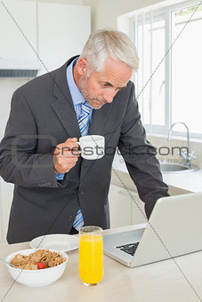 Focused businessman using laptop in the morning before work