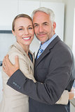 Happy business couple hugging each other before work in morning