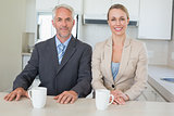 Happy business couple having coffee before work in morning