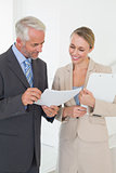 Smiling estate agent going over contract with customer