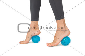 Close-up low section of woman standing over stress ball