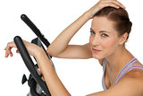 Close-up portrait of a beautiful young woman on stationary bike