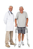 Portrait of a doctor with senior man using walker