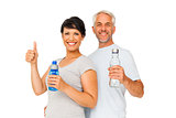 Fit couple with water bottles gesturing thumbs up