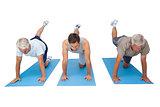 Full length of three men exercising