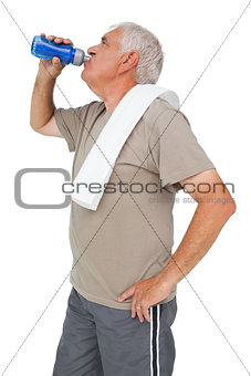 Active senior man drinking water