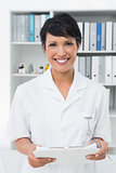 Smiling confident female doctor at medical office