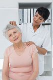 Female chiropractor doing neck adjustment