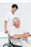 Nurse with senior patient sitting in wheelchair