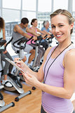 Trainer with people working out at spinning class