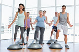 Full length portrait of people doing power fitness exercise