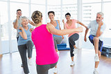 People doing power fitness exercise at yoga class in fitness studio
