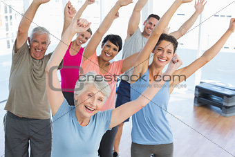 Portrait of smiling people doing power fitness exercise