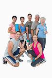 Full length portrait of happy fitness class