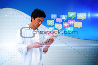 Casual man using tablet with app icons