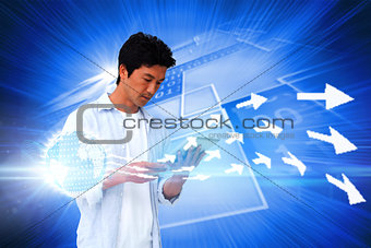 Casual man using tablet with arrows