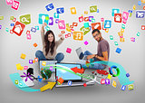 Cheering girl and casual man using laptop with app icons