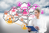 Blonde businesswoman using tablet pc with cloud computing graphic