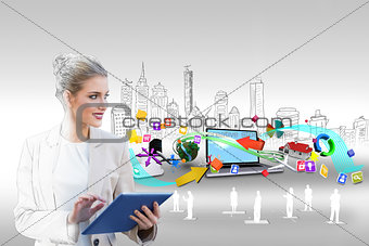 Blonde businesswoman using tablet pc with cityscape and laptop