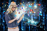 Stylish blonde using tablet pc with app icons and smartphone