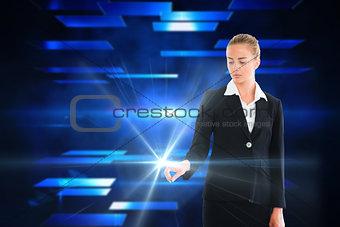 Blonde businesswoman touching light