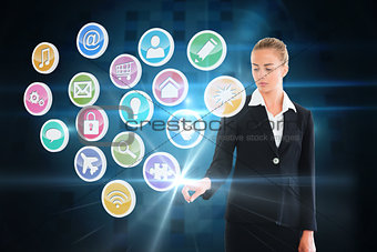 Blonde businesswoman touching app icon interface