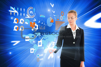 Blonde businesswoman touching interface