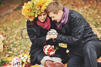 Great relationship. Young sweet couple having date in autumn park.