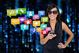 Glamorous brunette using smartphone with app icons