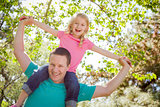 Cute Young Girl Rides Piggyback On Her Dads Shoulders